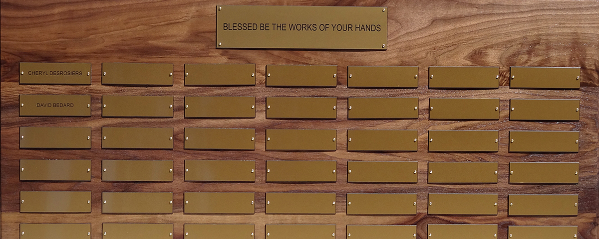 "2 foot x 3 foot 7"" custom solid walnut perpetual plaque with 49 gold plastic plates & beveled edges."
