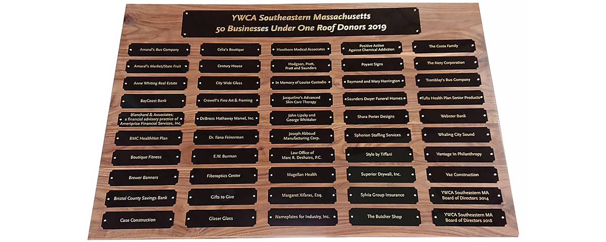 2 Foot x 3 foot custom walnut perpetual plaque with 50 black brass plates measuring 1.5 in x 6 in.