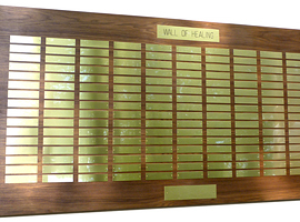 7 foot x 3 1/2 foot custom walnut perpetual plaque with 176 brass plates. Board finished by <a href='http://www.mjfwoodworking.com' target='new'>MJF Woodworking</a>.