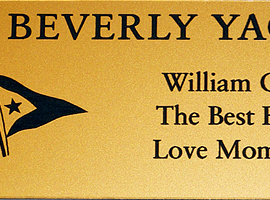 Laser engraved 1.5 in x 4 in. outdoor weatherable smooth gold/black plastic plate to be attached to adirondack chairs.