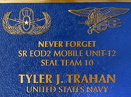 13 in. x 14 in. Bronze memorial plaque with raised letters, medium blue stain, leatherette background, & concealed studs.