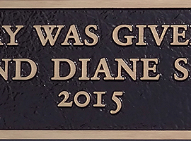 4 in. x 24 in. Bronze plaque with raised letters, dark oxide stain, leatherette background & through-the-face mount.