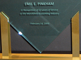 Diamond acrylic award with gold metal accents and rosewood stained piano finish base.
