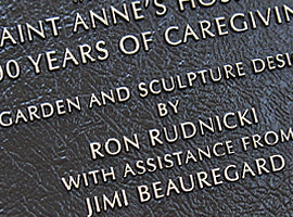7 in. x 9 in. Bronze dedication plaque with raised letters, dark oxide stain, leatherette background & concealed studs.