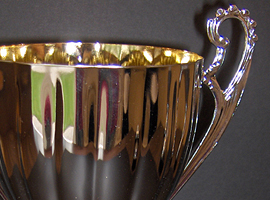 Trophy cup with plastic base.