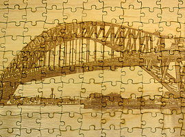 "Photo engraved wooden puzzle, 168 pieces in all measuring 9.5 in. x 6 in. Wood is about 1/8"" thick."