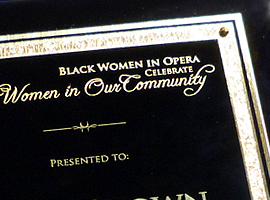 Laser engraved black stained piano finish plaque.